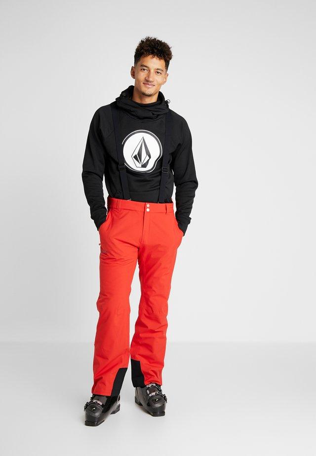 PUNTTI PANTS - Pantaloni da neve - lava red