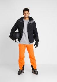 Halti - PUNTTI PANTS - Schneehose - vibrant orange - 1