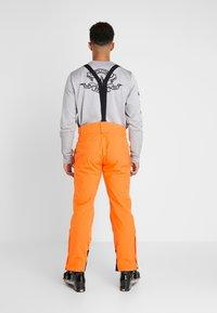 Halti - PUNTTI PANTS - Schneehose - vibrant orange - 2
