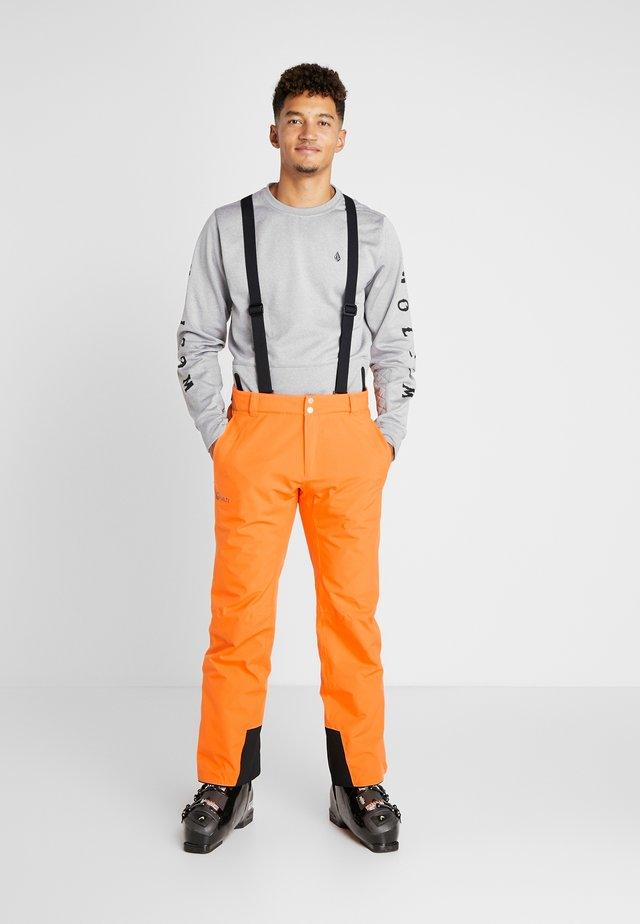 PUNTTI PANTS - Spodnie narciarskie - vibrant orange