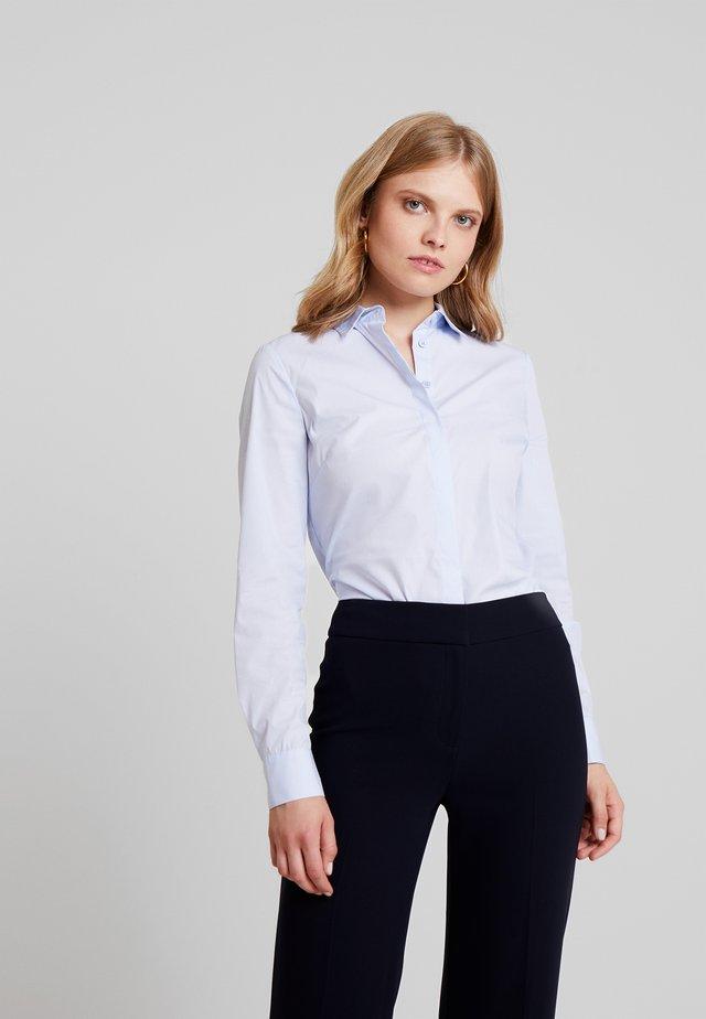 VICTORIA - Button-down blouse - pale blue