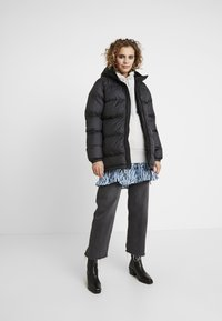 Helly Hansen - PUFFER - Winter coat - black - 1