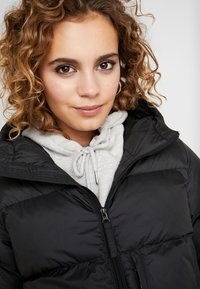 Helly Hansen - PUFFER - Winter coat - black - 4