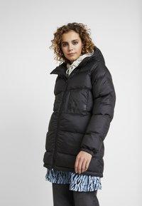 Helly Hansen - PUFFER - Winter coat - black - 0