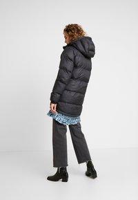 Helly Hansen - PUFFER - Winter coat - black - 2