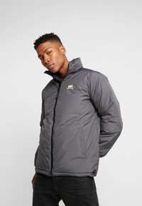 Helly Hansen - REVERSIBLE PUFFER JACKET  - Veste d'hiver - black - 3
