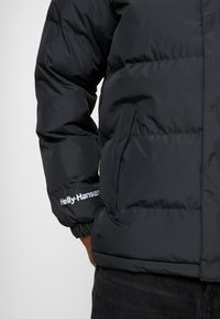 Helly Hansen - REVERSIBLE PUFFER JACKET  - Veste d'hiver - black - 7