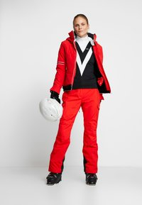 Helly Hansen - SWITCH CARGO 2.0 PANT - Snow pants - alert red - 1
