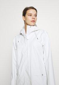 Helly Hansen - MOSS RAIN COAT - Waterproof jacket - offwhite - 3