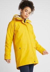 Helly Hansen - MOSS INS COAT 2-IN-1 - Sadetakki - essential yellow - 0