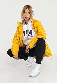 Helly Hansen - LOGO HOODIE - Hoodie - white - 1