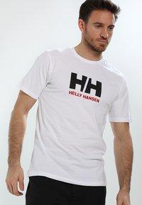 Helly Hansen - LOGO - T-shirt med print - white - 0