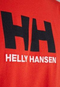 Helly Hansen - LOGO - T-shirt med print - alert red - 5