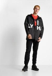 Helly Hansen - LOGO - T-shirt med print - alert red - 1