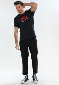 Helly Hansen - LOGO - T-shirt imprimé - navy - 1