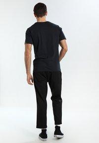 Helly Hansen - LOGO - T-shirt imprimé - navy - 2