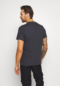 Helly Hansen - NORD GRAPHIC  - Print T-shirt - ebony - 2