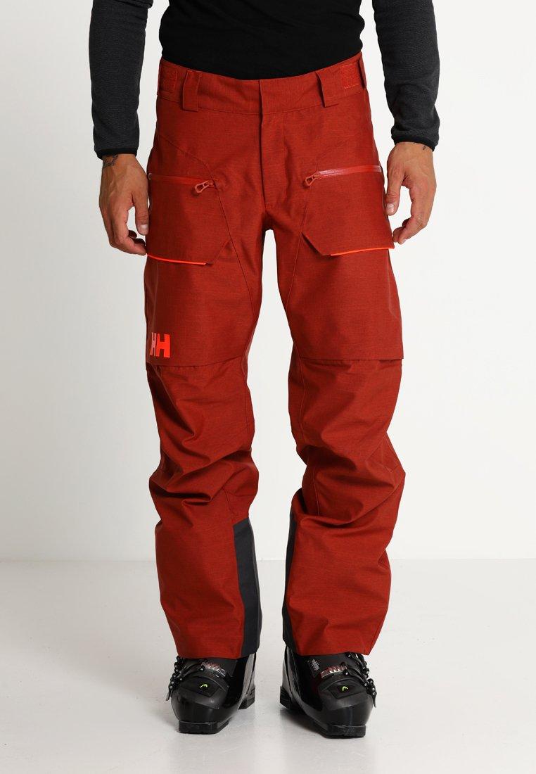 Helly Hansen - GARIBALDI PANT - Zimní kalhoty - red brick