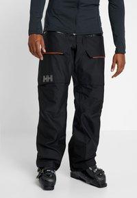 Helly Hansen - GARIBALDI PANT - Pantalon de ski - black - 0