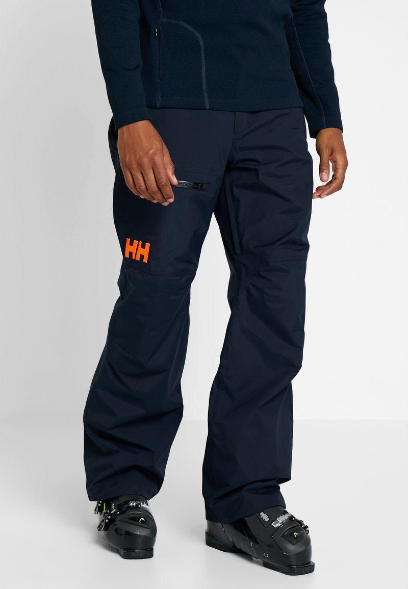 Helly Hansen - SOGN CARGO PANT - Pantalón de nieve - navy