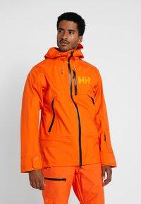 Helly Hansen - SOGN JACKET - Hardshell jacket - bright orange - 0