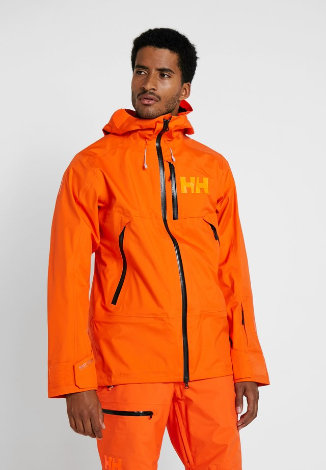SOGN JACKET - Hardshell jacket - bright orange
