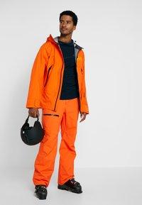 Helly Hansen - SOGN JACKET - Hardshell jacket - bright orange - 1