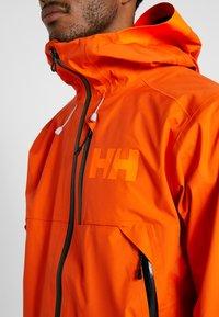 Helly Hansen - SOGN JACKET - Hardshell jacket - bright orange - 3