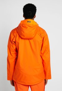 Helly Hansen - SOGN JACKET - Hardshell jacket - bright orange - 2