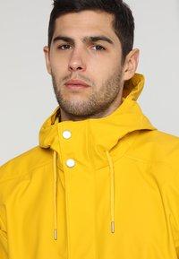 Helly Hansen - MOSS RAIN COAT - Waterproof jacket - essential yellow - 3