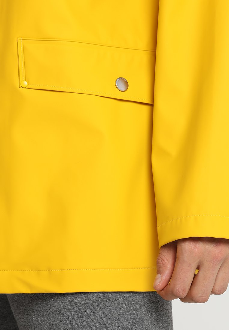Helly Hansen MOSS RAIN COAT - Impermeabile - essential yellow