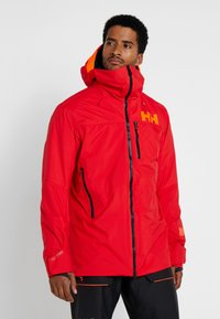 Helly Hansen - STRAIGHTLINE LIFALOFT JACKET - Snowboardová bunda - alert red - 0