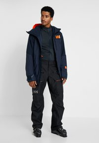 Helly Hansen - STRAIGHTLINE LIFALOFT JACKET - Snowboardová bunda - navy - 1