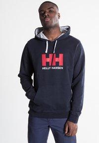 Helly Hansen - LOGO HOODIE - Hoodie - navy - 0