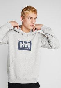 Helly Hansen - TOKYO HOODIE - Hoodie - grey melange - 0