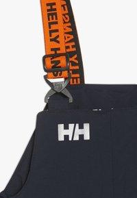 Helly Hansen - RIDER - Zimní kalhoty - navy - 4