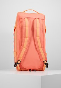 Helly Hansen - SCOUT DUFFEL S - Sports bag - living coral - 6