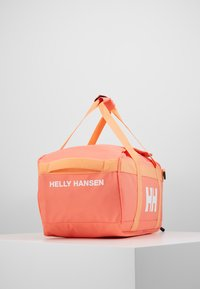 Helly Hansen - SCOUT DUFFEL S - Sports bag - living coral - 4