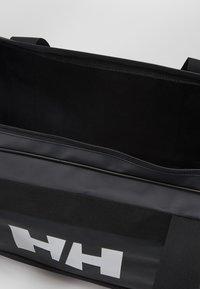 Helly Hansen - SCOUT DUFFEL M - Sportovní taška - black - 3