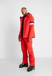 Head - SUMMIT PANTS - Pantalon de ski - red - 1