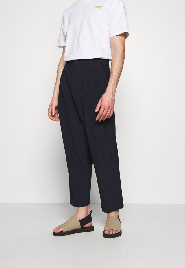 SLOWLY STICKY PANTS - Trousers - dark navy
