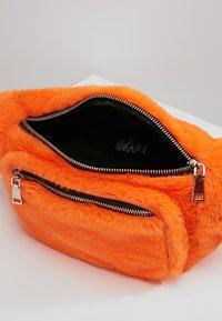 Hikari - FURRY BUM BAG  - Bum bag - orange - 4