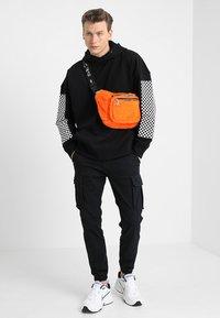 Hikari - FURRY BUM BAG  - Bum bag - orange - 1