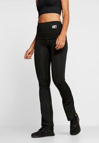 HIIT - WAGTAIL KICKFLARE - Pantalones deportivos - black - 0