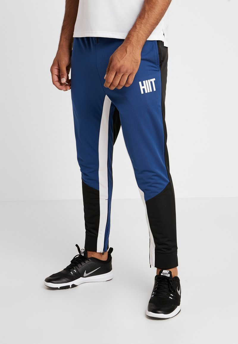 HIIT - PANELLED CARROT FIT - Pantalones deportivos - black
