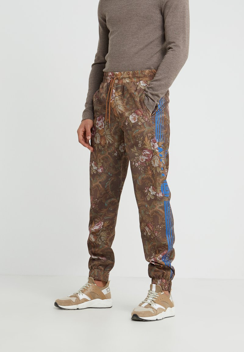 Han Kjobenhavn - TRACK PANTS - Pantalones deportivos - brown