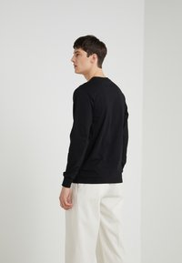 Han Kjobenhavn - CASUAL LONG SLEEVE - Long sleeved top - black - 2