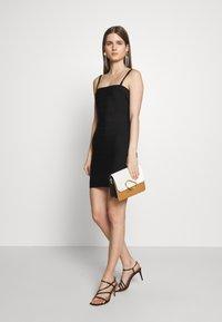 Hervé Léger - CONVERTIBLE STRAP ICON - Pouzdrové šaty - black - 1