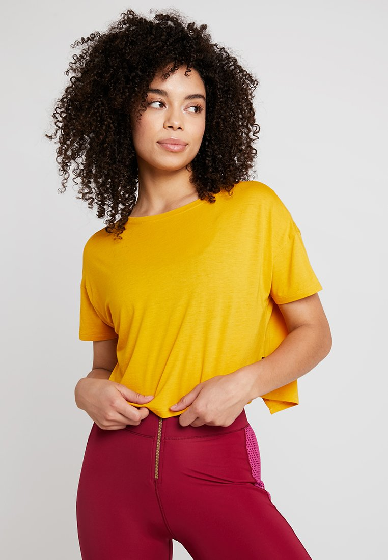 Hunkemöller - TEE OPEN BACK - T-Shirt print - mango mojito
