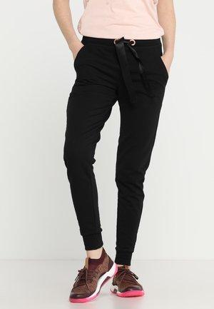 SKINNY - Teplákové kalhoty - black